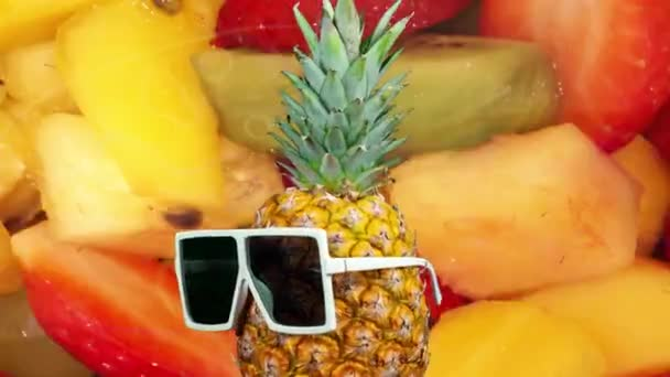 Moving pineapple in sunglasses with fruits at background