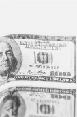 Fotografie close-up view of blurred dollar banknotes, prosperity and business success concept