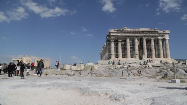tourists walking near antique ruins of acropolis, Athens, Greece