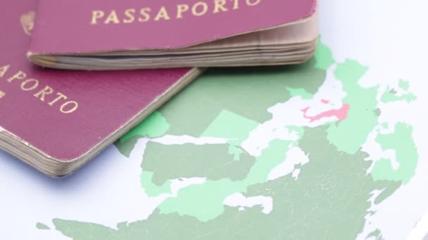 red passports on world map background