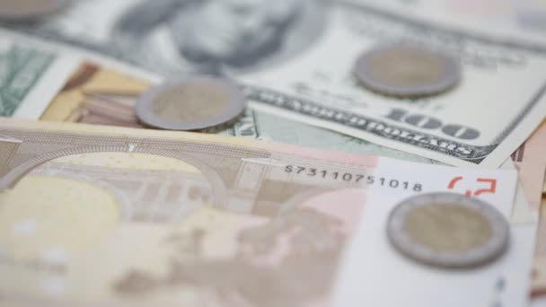 close-up footage of dollar, euro banknotes and coins for background