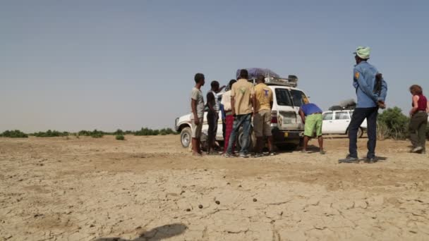 in  ethiopia africa  unidentified people in the desert changin the tyres