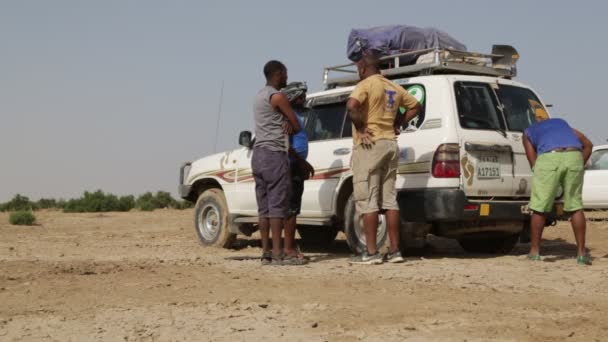 ETHIOPIA, DANAKIL - CIRCA DECEMBER 2017: unidentified people in desert changing tyres