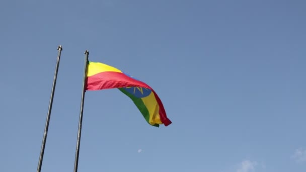 bottom view of colorful waving Ethiopian Flag against blue sky
