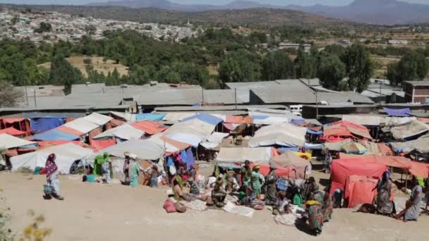 scenic view of unidentified people in old market during daytime