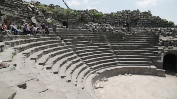 tourists visiting antique theater and archaeological site