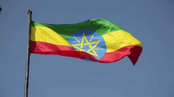 bottom view of Ethiopian Flag against clear blue sky