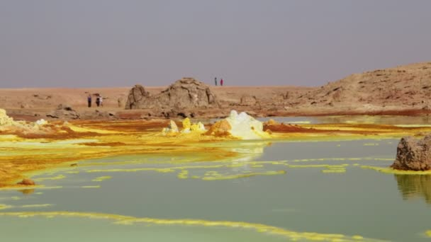 footage of tourists walking at volcanic depression of dallol, ethiopia, africa