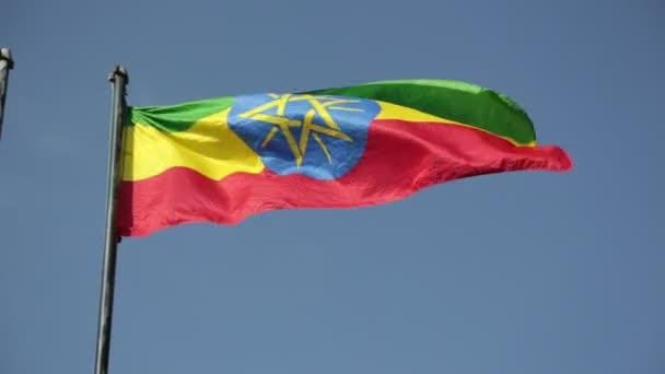 bottom view of Ethiopian Flag on wind against blue sky