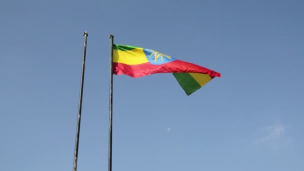 bottom view footage of waving colorul Ethiopian Flag against blue sky