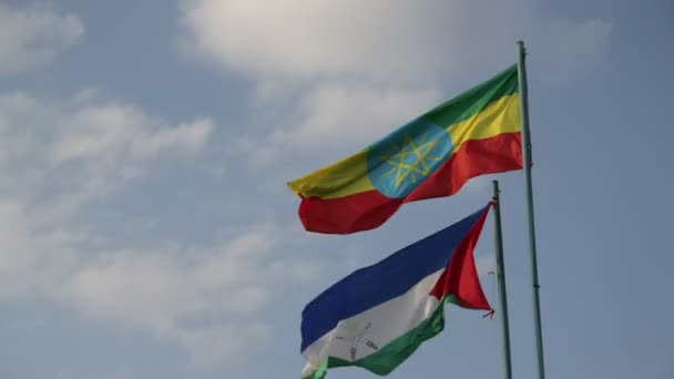 bottom view of Ethiopian Flag and Flag of Afar against cloudy sky