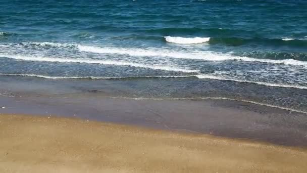 view of ocean waves and sandy beach