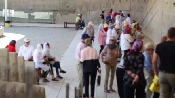tourists in Persepolis old ruins, historical destination monuments in Iran