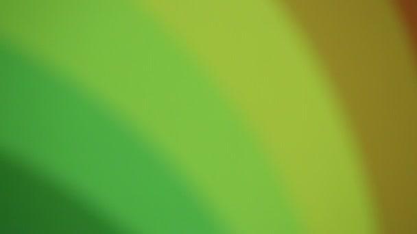 zelené, žluté a červené abstraktní Duhová spirála pozadí