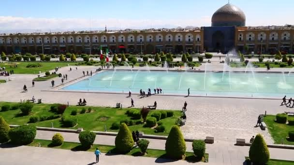 high angle view of people walking on old square in iran