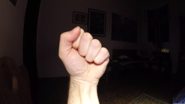 close-up footage of male hand gesturing on black background