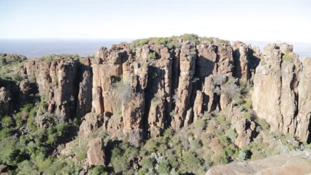 scenic view of valley of desolation with dirty road, rocks and sky in south africa