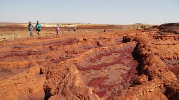 ETHIOPIA, DALLOL - CIRCA DECEMBER 2017: unidentified people walking in the volcanic depression