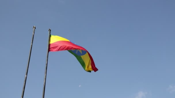bottom view footage of Ethiopian Flag against clear blue sky