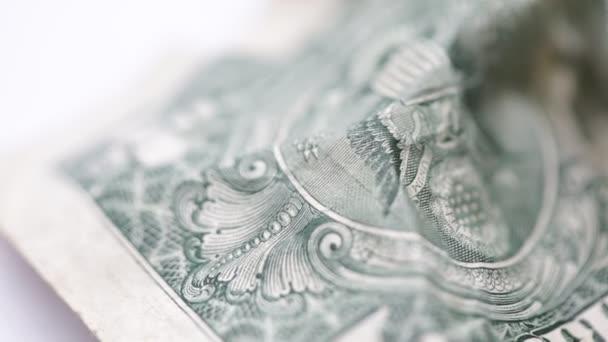 Podrobný záběr dolarové bankovky na pozadí