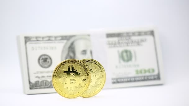 bitcoins and dollar banknotes on white background, like concept of money and investment