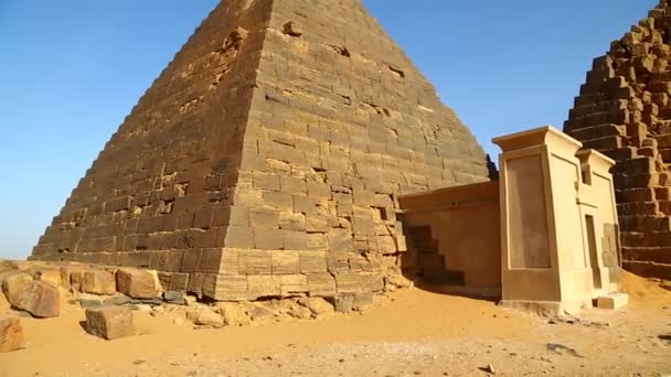 unidentified people near antique temple of black pharaohs in sahara desert