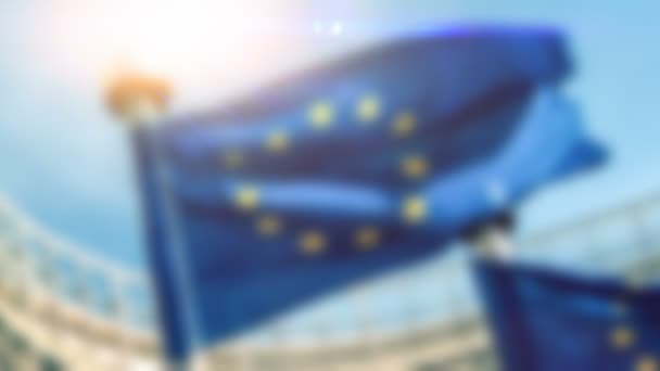 Blurred background with waving EU flags