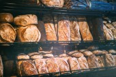 Freshly baked bread in rustic bakery. Food and drink background