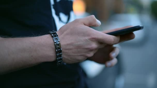 Mans hands with smartphone chatting
