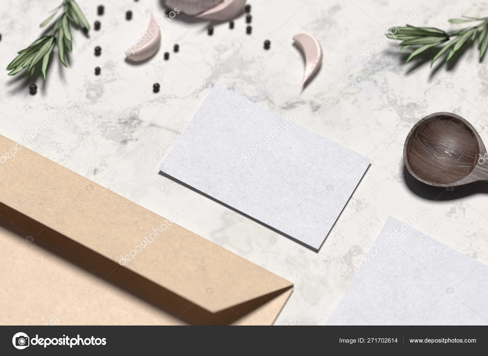 Blank envelope and business card near wooden spoon and