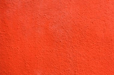 Bright orange painted stucco wall background stock vector