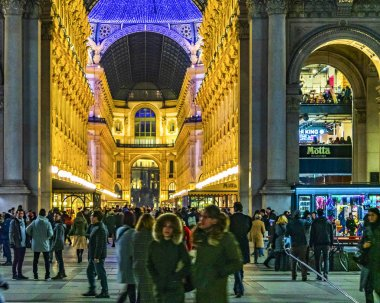 MILAN, ITALY, JANUARY - 2018 - Urban night scene at famous duomo piazza at historic center of milan city, Italy