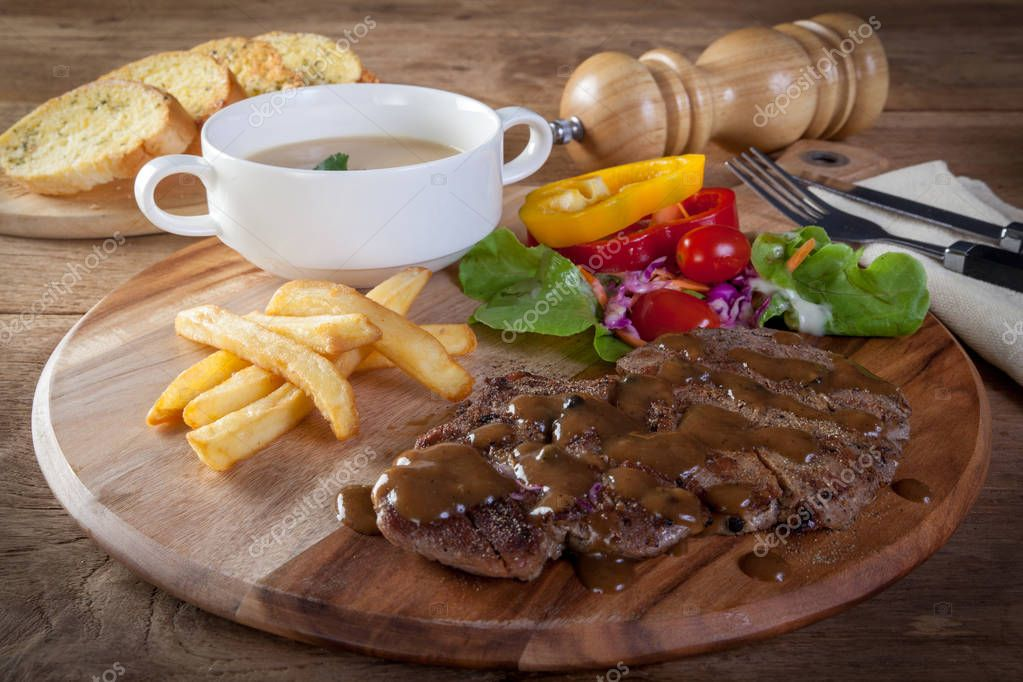 Black pepper steak Served with Garlic Bread and Mushroom Soup