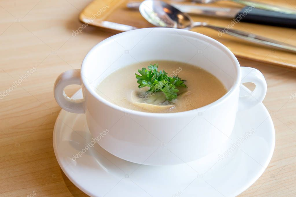 Mushroom soup on wooden table.