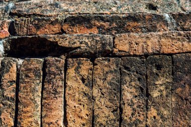 The ancient brick wall was neatly arranged and so strong that there was no space
