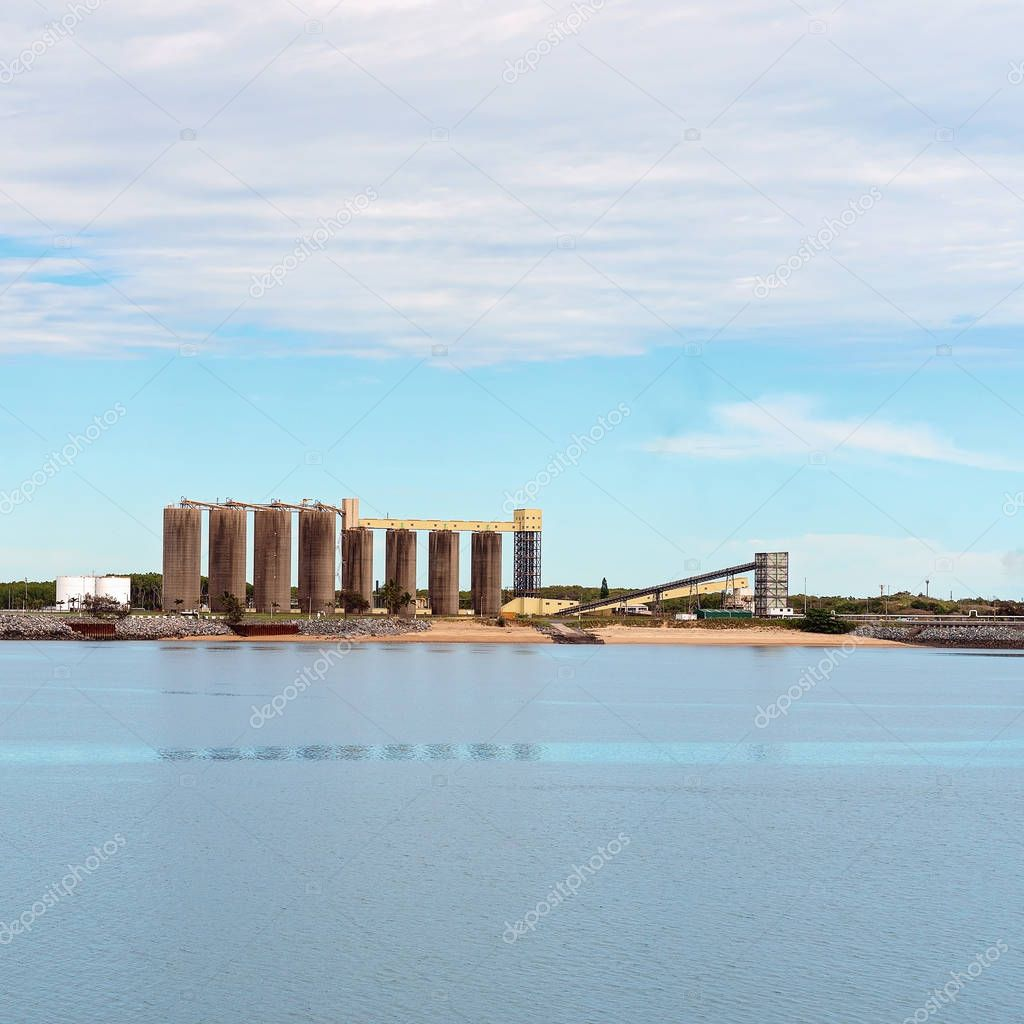 Industrial wharf of an Australian city's harbor with infrastructure for exporting mining and agricultural products