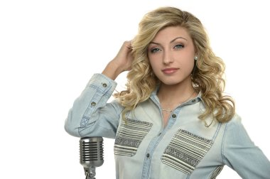 Young Singer woman with microphone