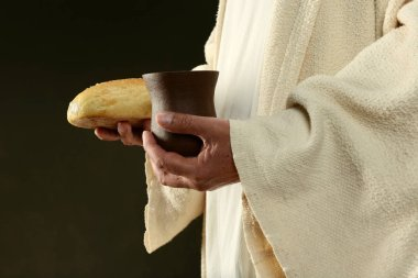 Jesus holding bread and a cup of wine