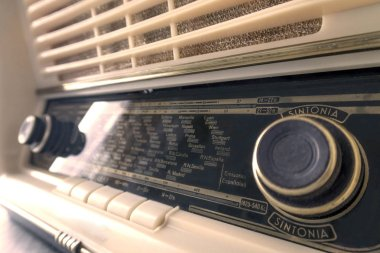 Vintage old radio, on white background and close-up. antiquarian. light bulb transistor