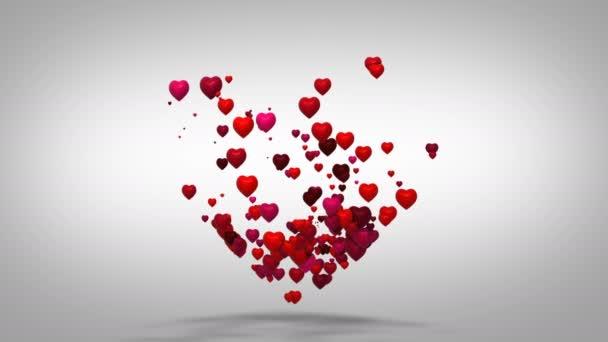 Pozadí je Valentýn tvar srdce. Mnoho srdcí tvoří jedno velké srdce. Létající láska červené srdce na bílém podkladu.