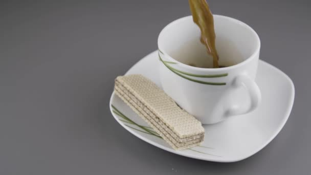 Pouring coffee in a cup.