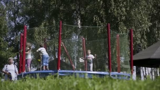 Kids are having fun on trampoline.