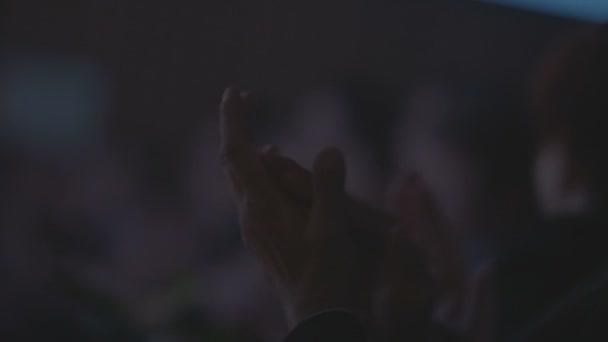 People at seminar applauding