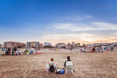Valencia, Spain - June 23, 2019: Mature married couple resting o