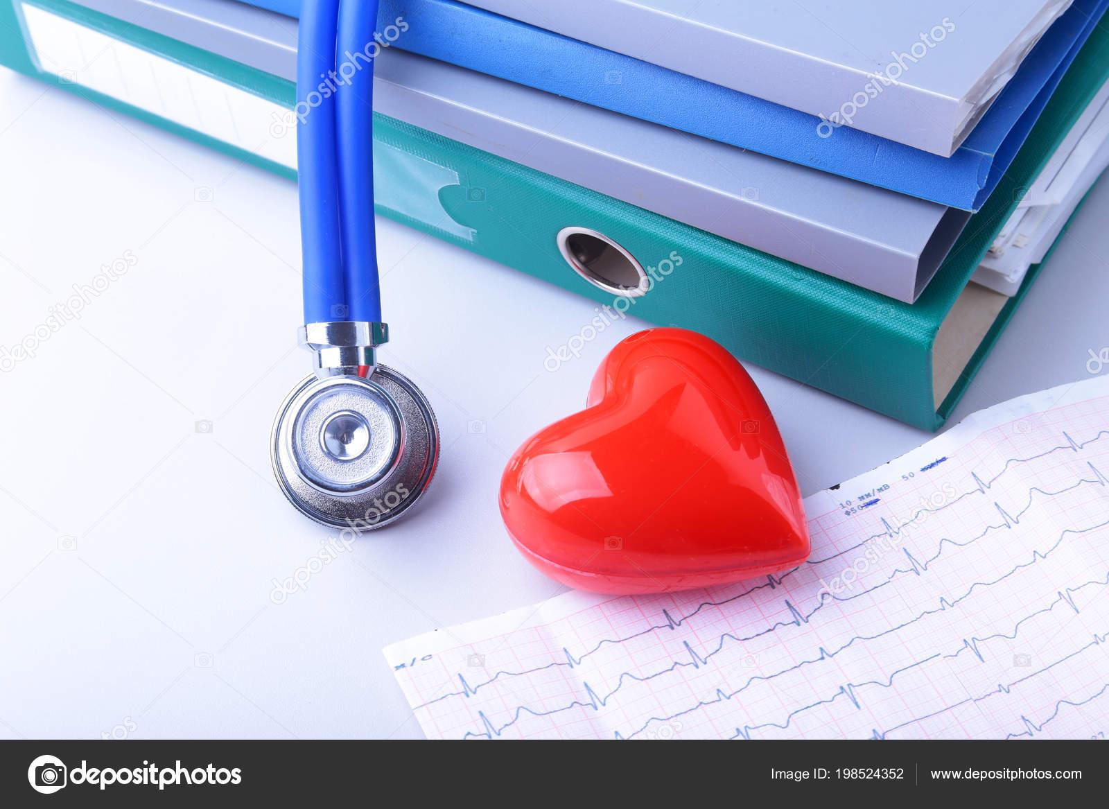 books folder file, stethoscope, red heart and RX prescription