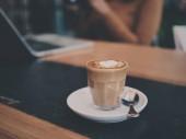coffee latte art in coffee shop cafe vintage color tone