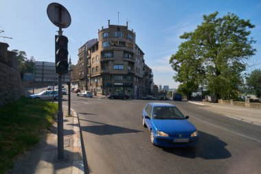 Belgrade, Serbia - May 03, 2018: Morning view on Bulevar vojvode Bojovica boulevard with blue car passing by.