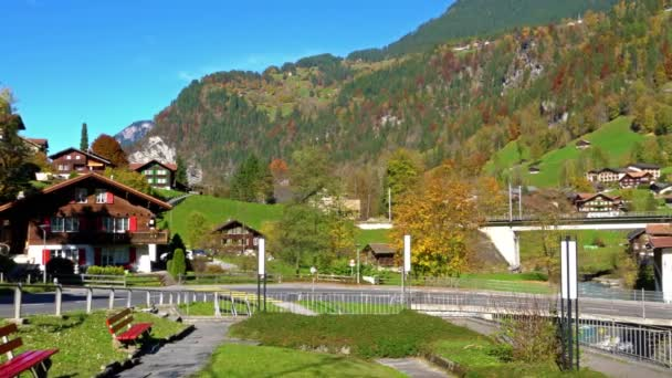 Traditional Chalets of village in Lauterbrunnen Valley at autumn, Berner Oberland, Switzerland
