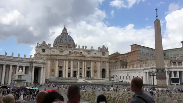 Rome - September, 2019 - Slow forward movement of the camera frames a tour guide who explains to his group something about the square and the Basilica of San Pietro in Vatican