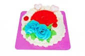 Torte with marzipan roses, close up of sweet food on white background with clipping path
